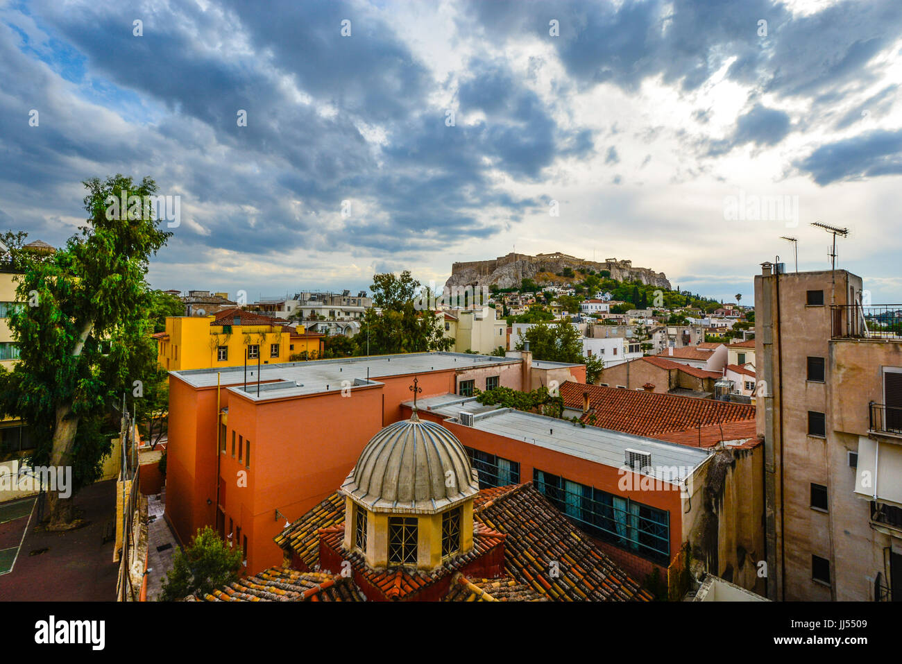 Athens Greece view of the Acropolis and Parthenon on a late afternoon in the summer from a window in the Plaka district - Stock Image
