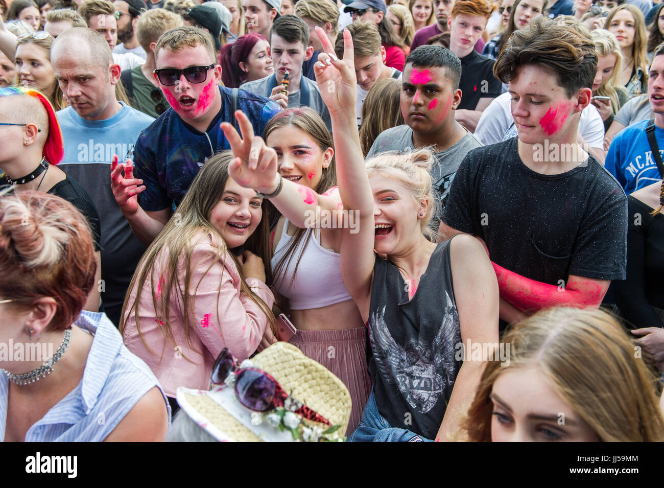 Female teenage music fans pose for the camera during the 2017 Godiva Music Festival, Coventry, UK. - Stock Image