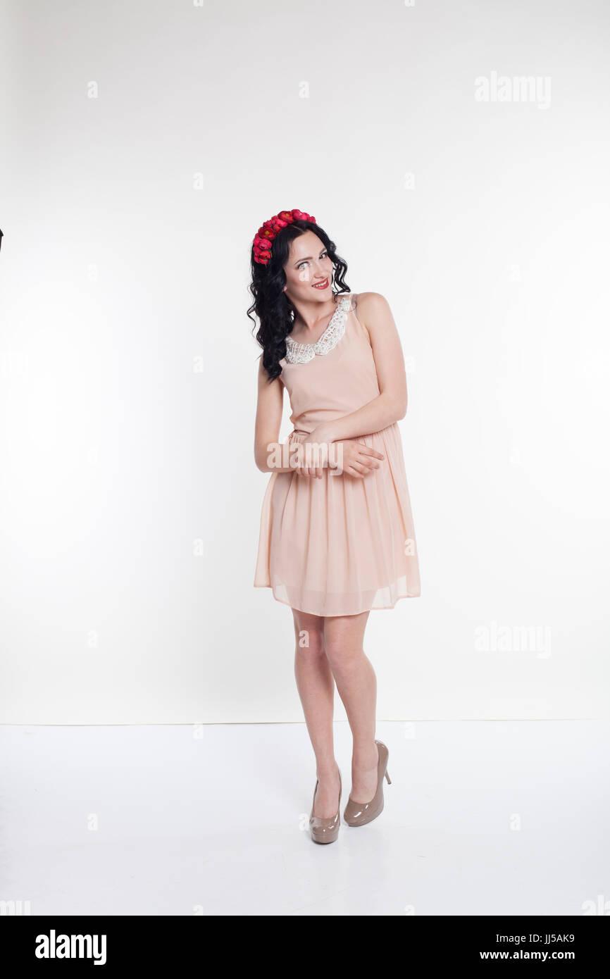 a beautiful cocktail dress stylish girl wreath - Stock Image