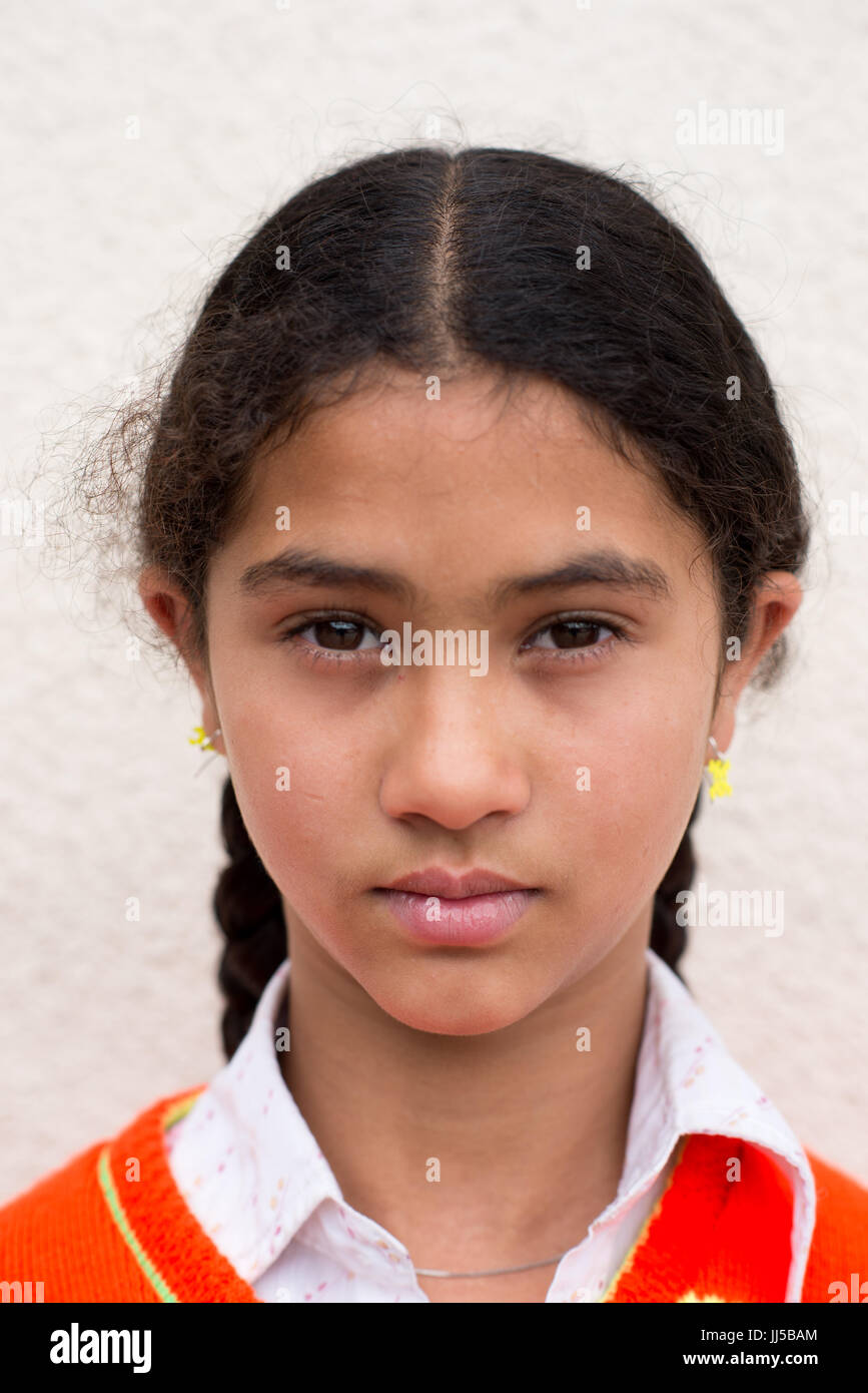 A girl of a Rom community with braids, valeni, Transylvania, Romania - Stock Image