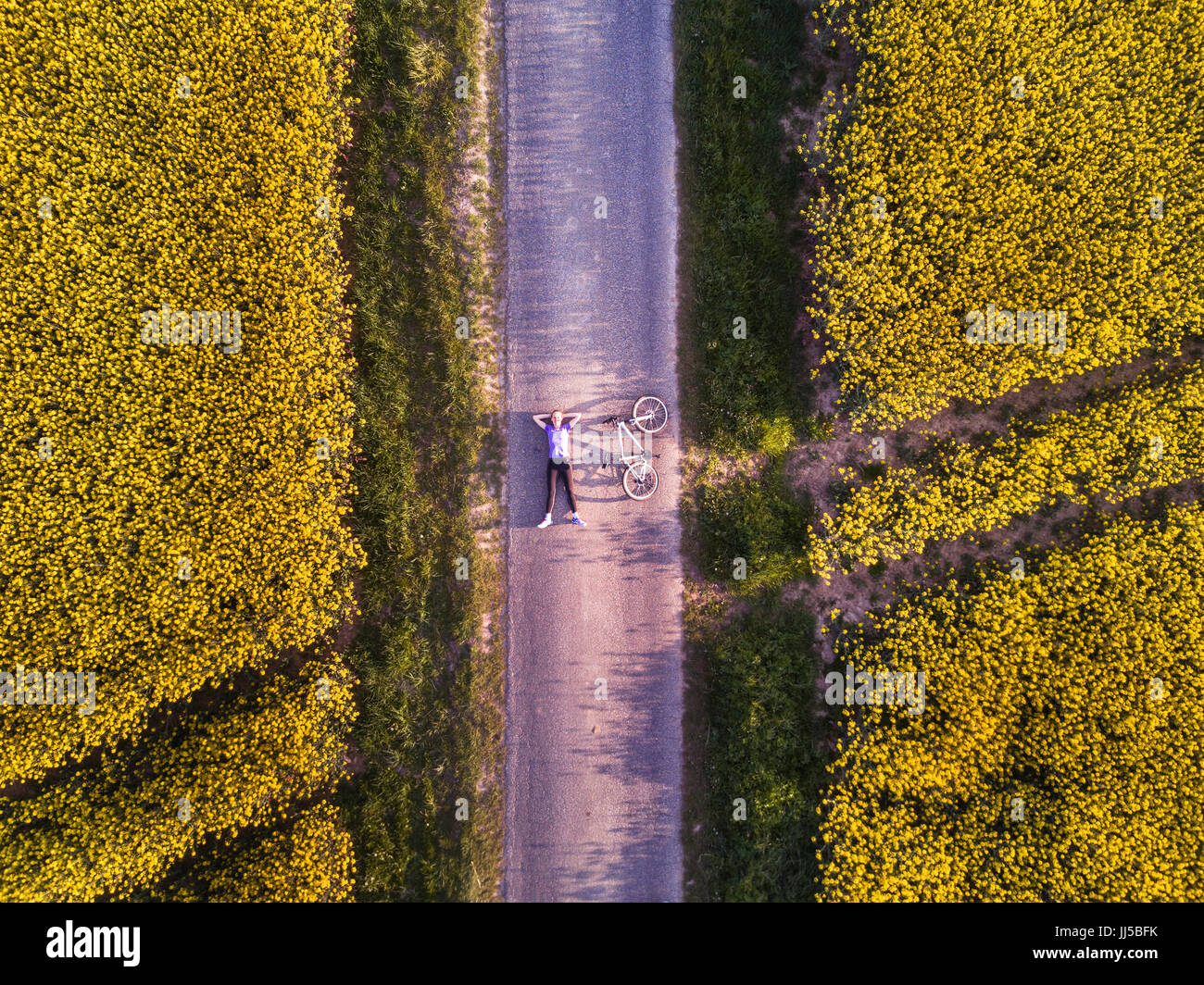 Top View Of Person With Bicycle On The Road In Fields Aerial Shot