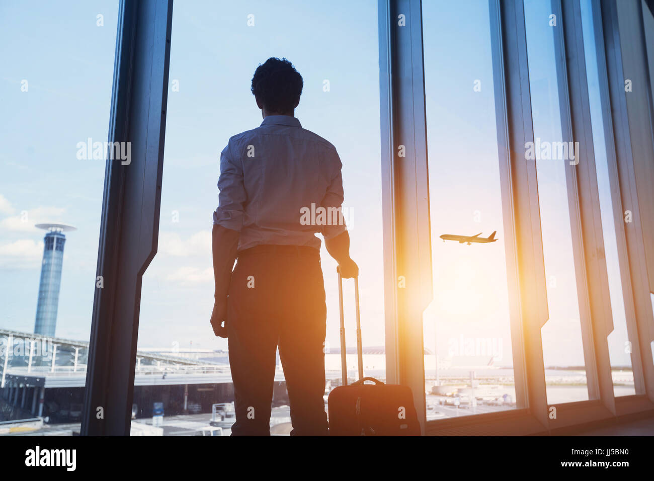 travel concept, business man silhouette in airport - Stock Image