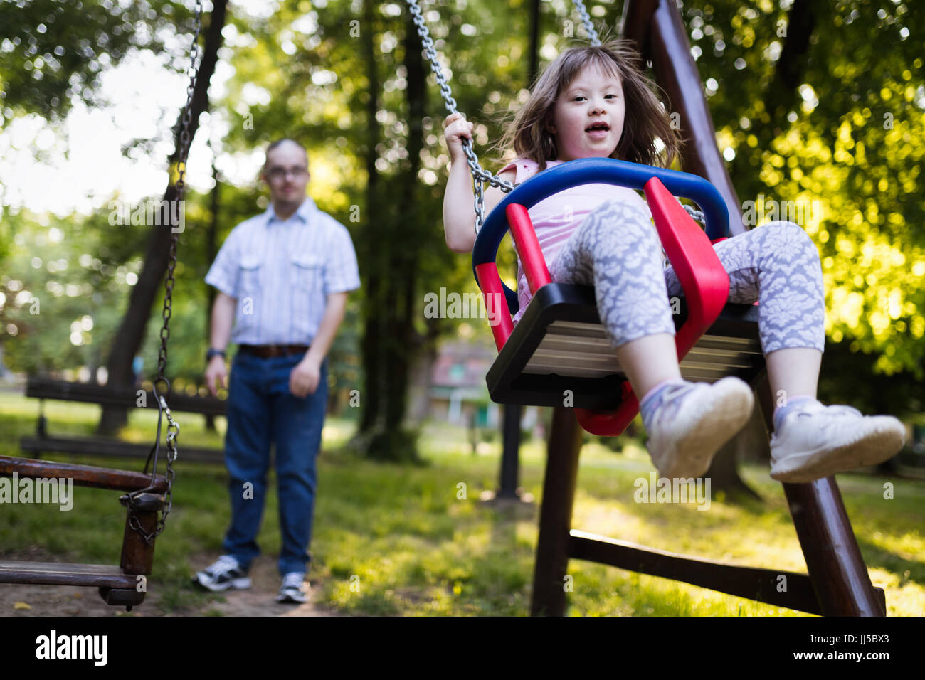 Portrait of young girl with down syndrome - Stock Image