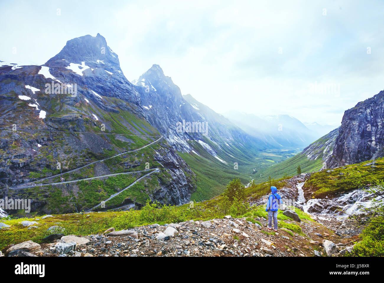 Trollstigen in Norway, tourist looking at mountain road in stunning beautiful landscape - Stock Image