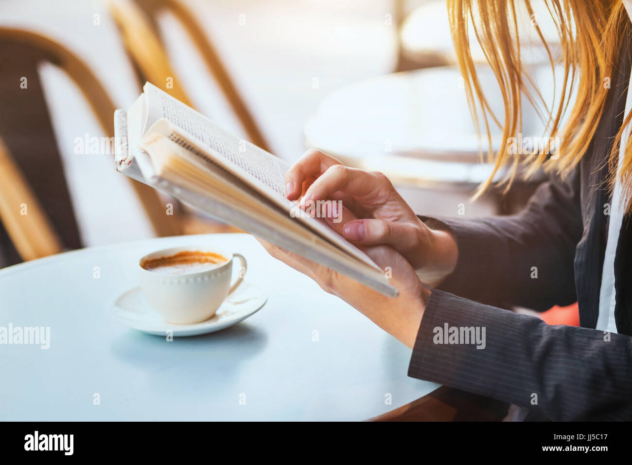 reading concept, close up of woman hands holding a book - Stock Image