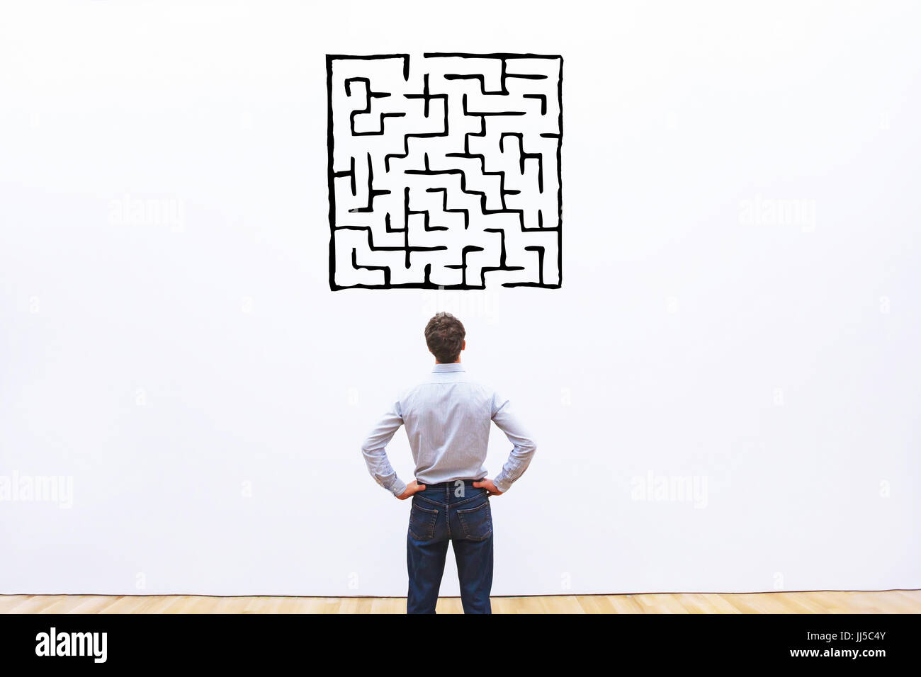 business man looking at labyrinth drawing, complicated difficult solution concept - Stock Image