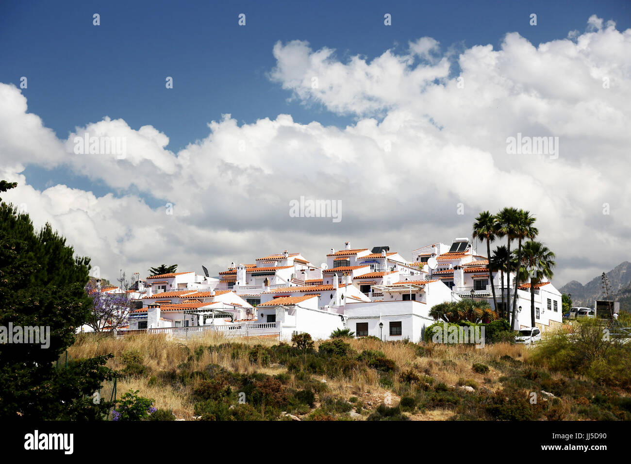 A view of a housing development in Alumenecar, Andalusia, Spain, Costa del Sol, Mediterranean, Spain. Stock Photo