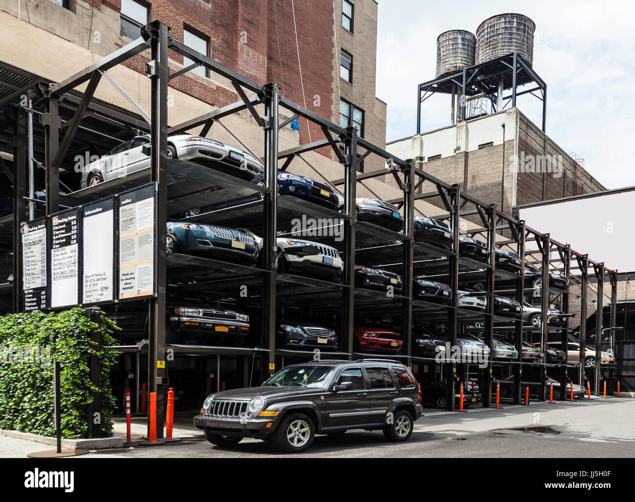 Car stack parking in New York saves space but can take longer to retrieve your vehicle Stock Photo