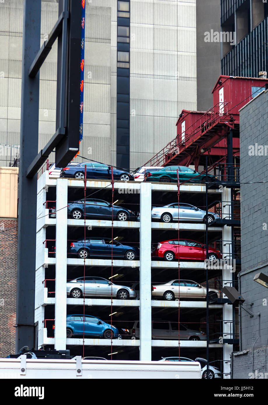 Car stack parking in New York saves space but can take longer to retrieve your vehicle - Stock Image
