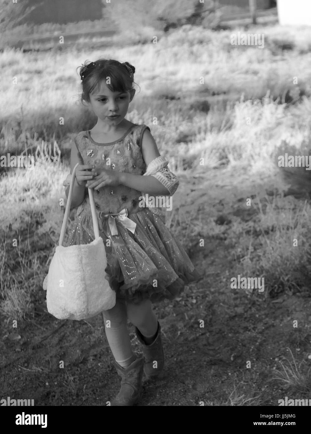 28c50b8b3 Black and white photo of little girl wearing a tutu and cowboy boots on an  Easter