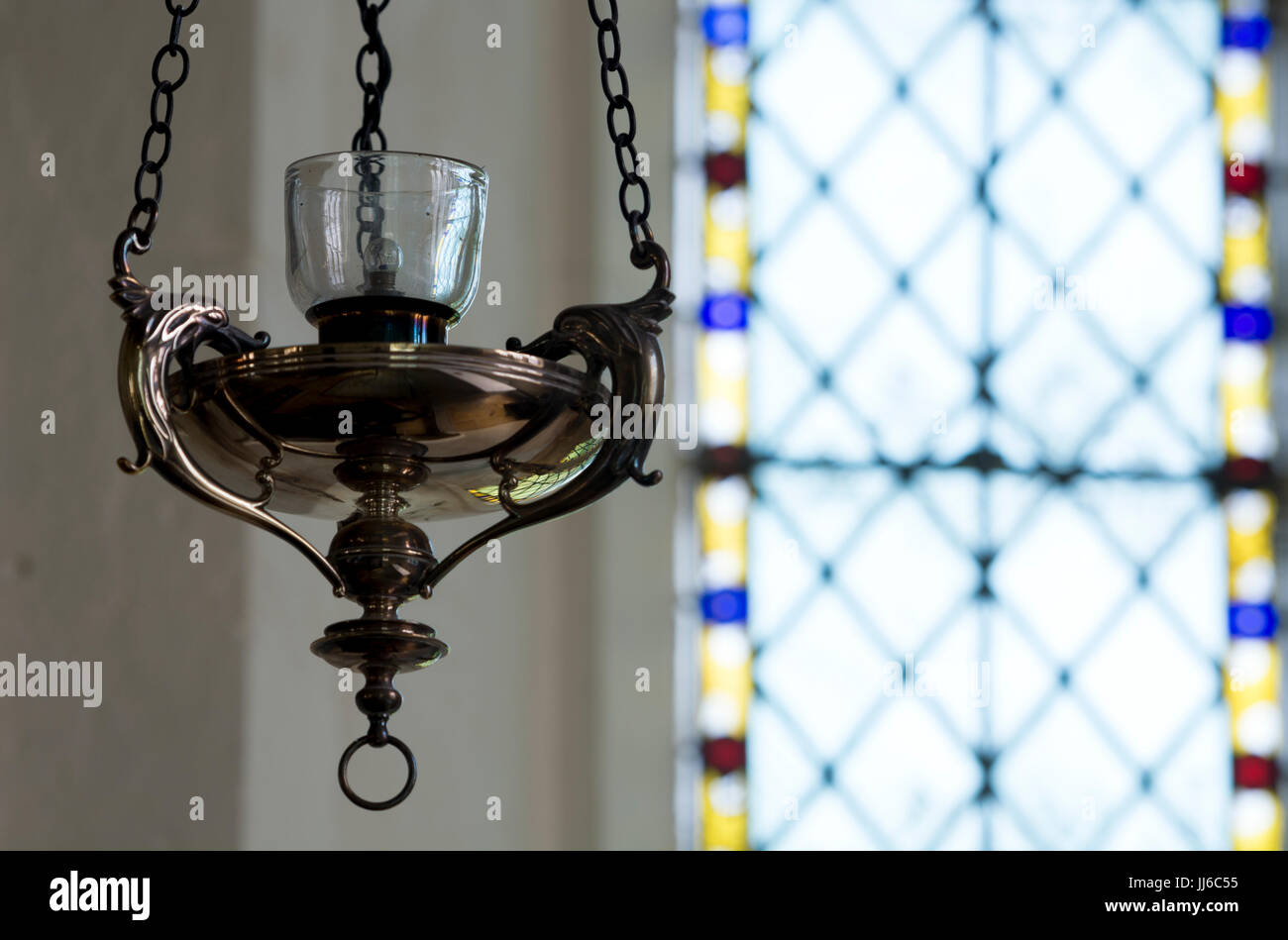 A sanctuary lamp in St. Mary`s Church, Ardley, Oxfordshire, UK - Stock Image