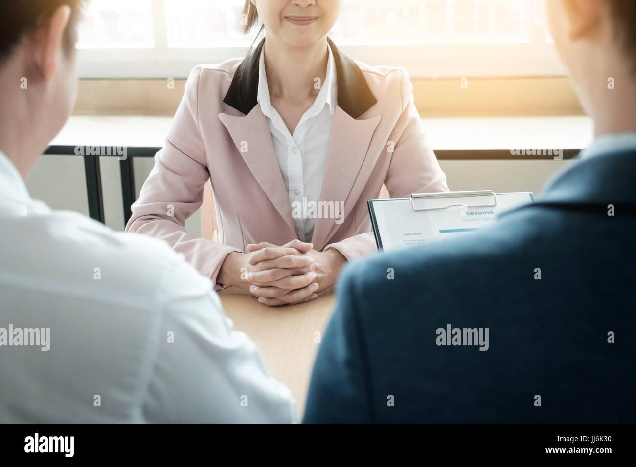 beautiful woman and her job interview in office (work). - Stock Image