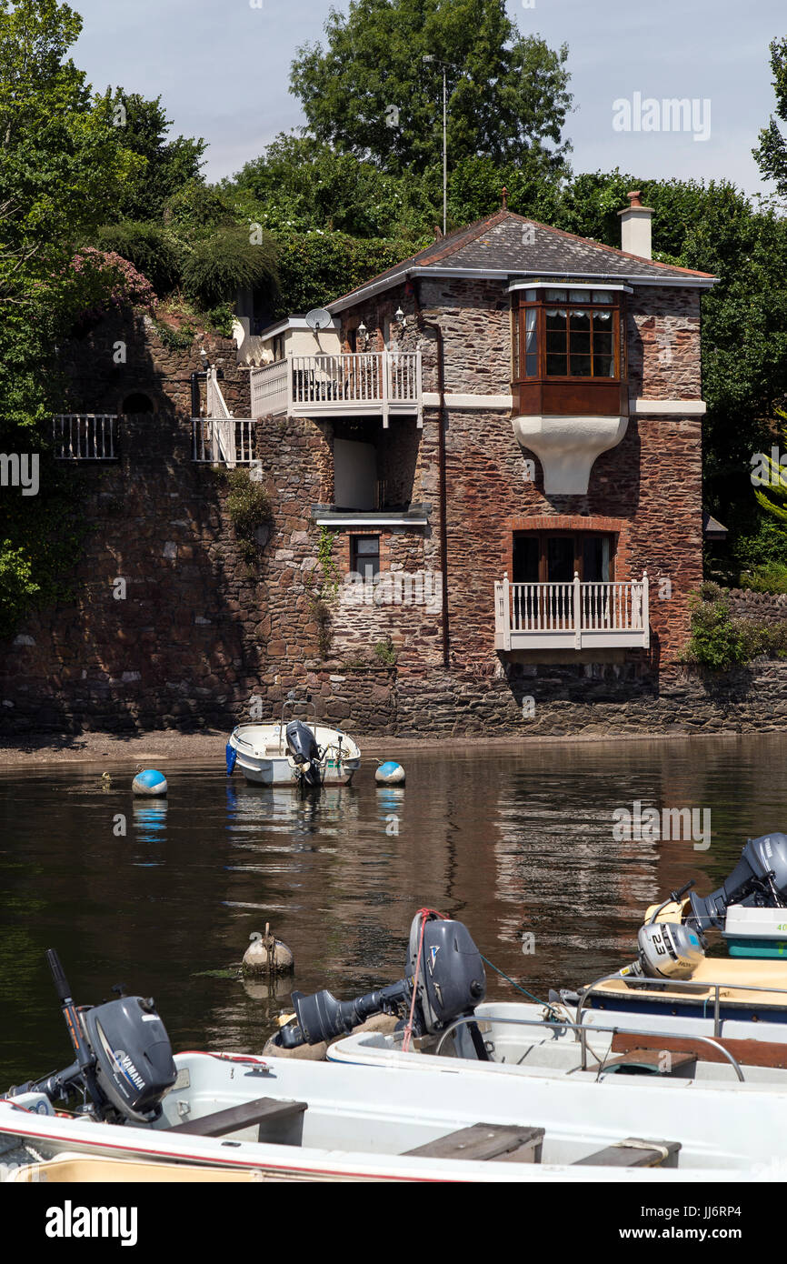 Boats moored in the creek at Stoke Gabriel in the South Hams Devon England UK Europe,A canoe is a lightweight narrow - Stock Image