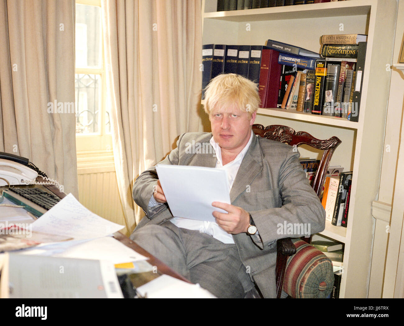 Boris Johnson conservative MP and editor of the Spectator magazine photographed in the Spectator magazine office - Stock Image