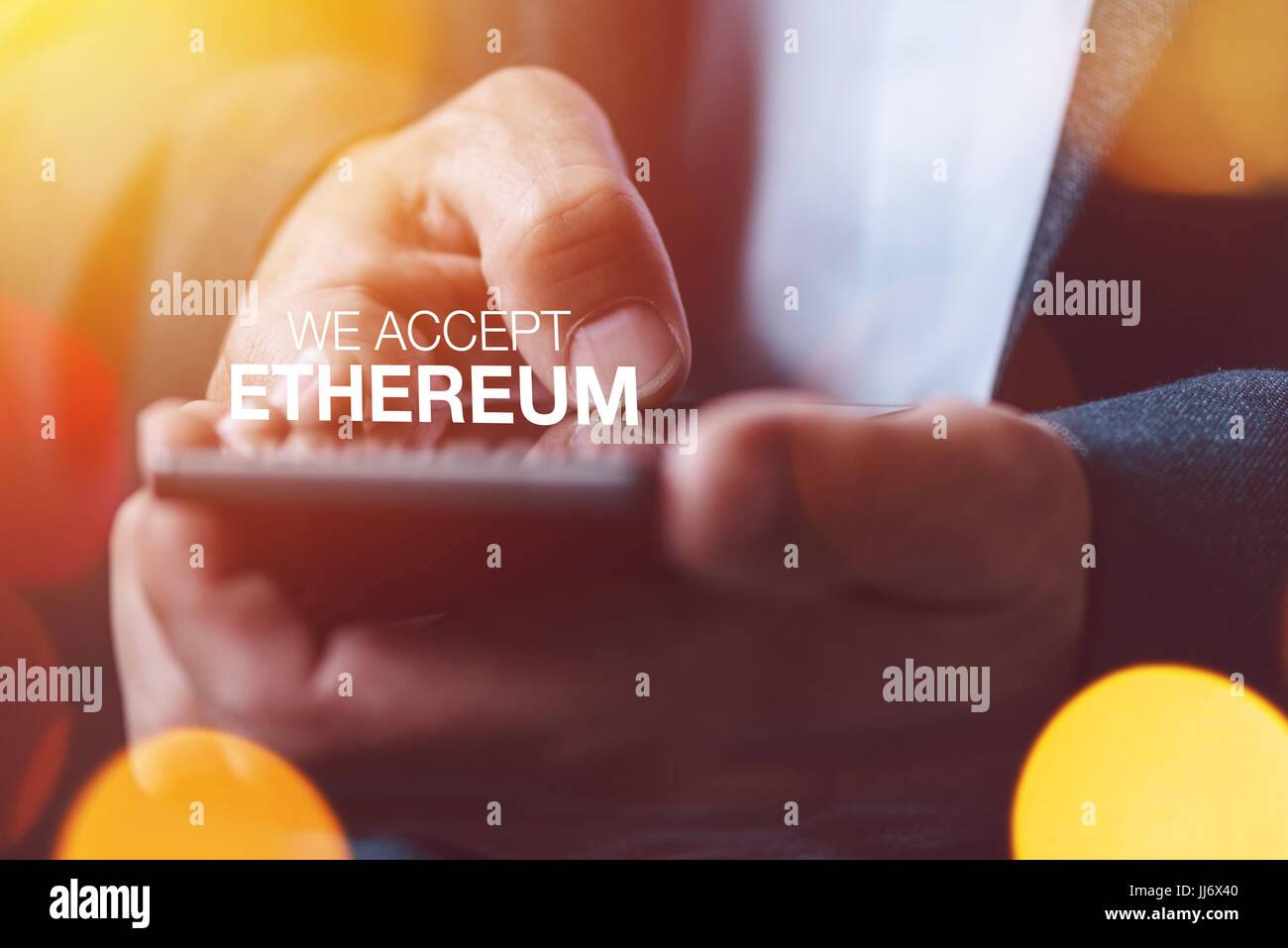 We accept Ethereum cryptocurrency concept with businessman - Stock Image