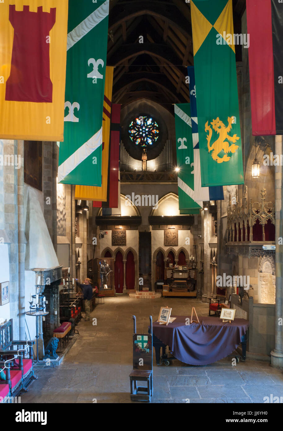 The Great Hall of the Hammond Castle, in Gloucester, Massachusetts. Colorful banners of arms are hanging from the - Stock Image