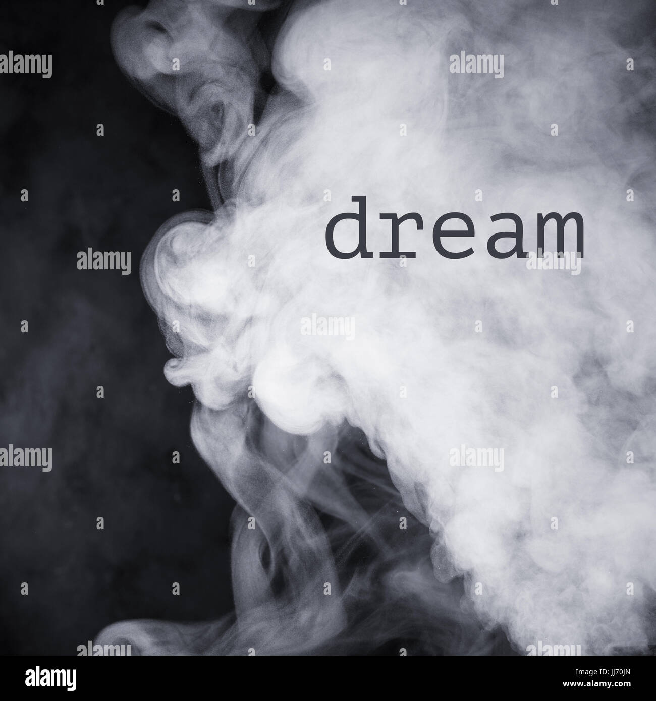 Inscription Dream on the abstract image of smoke. Stock Photo