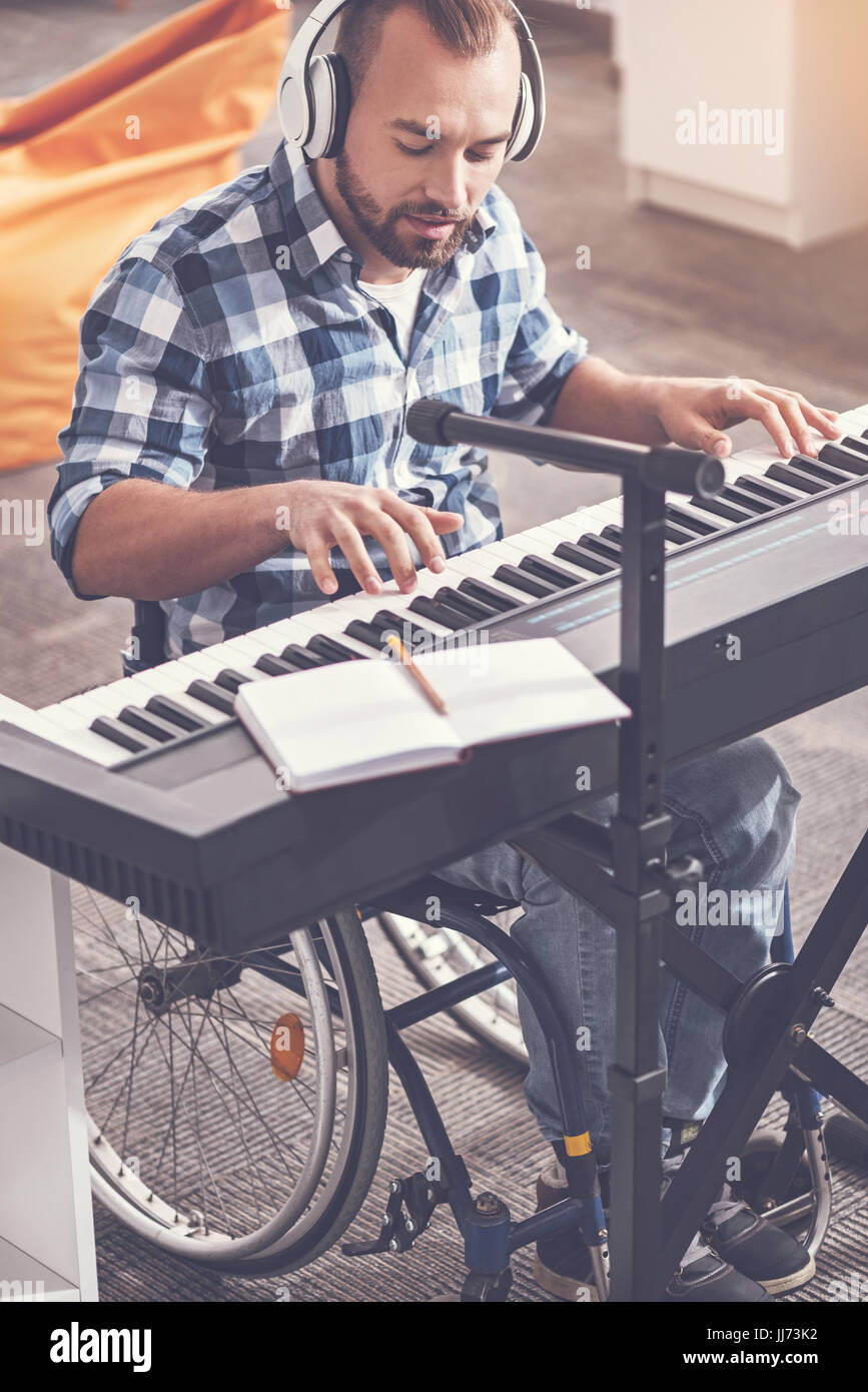 Young composer writing new track - Stock Image