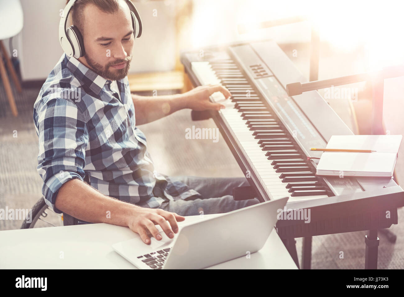 Delighted bearded man making new single - Stock Image