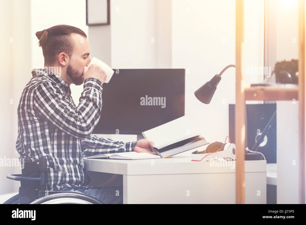 Profile photo of office worker that drinking tea - Stock Image