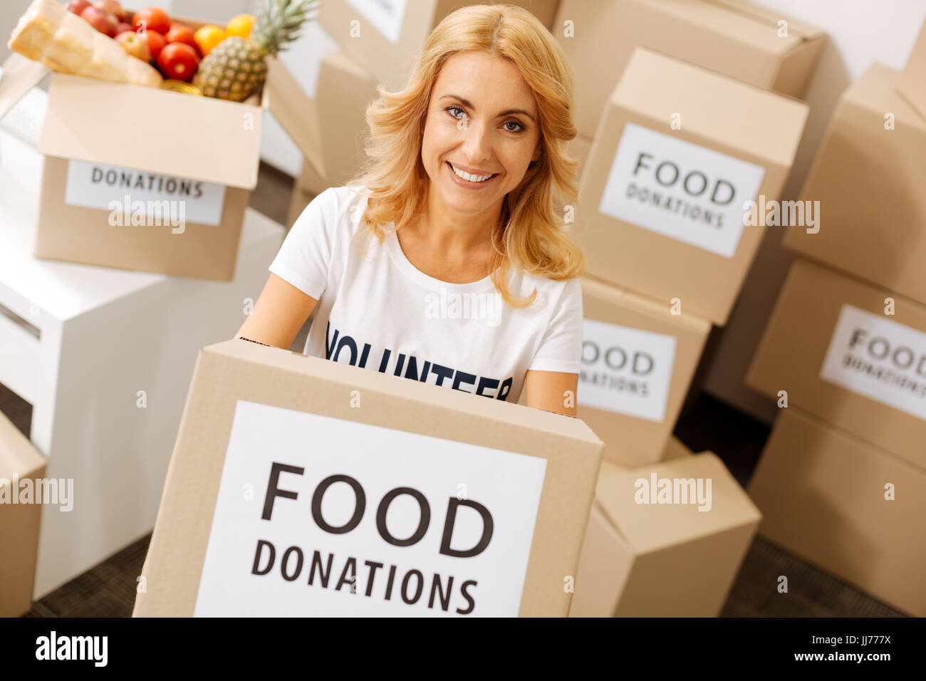 Pretty emotional lady serving as a volunteer Stock Photo