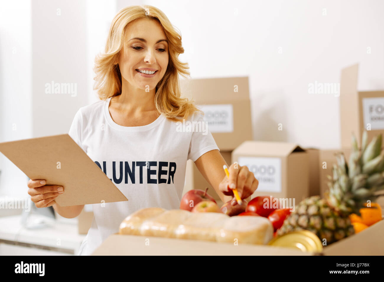 Diligent stunning woman keeping supplies in check Stock Photo