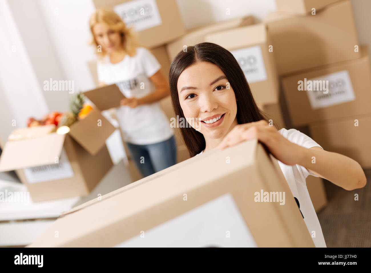 Wonderful energetic woman getting the shipments ready Stock Photo
