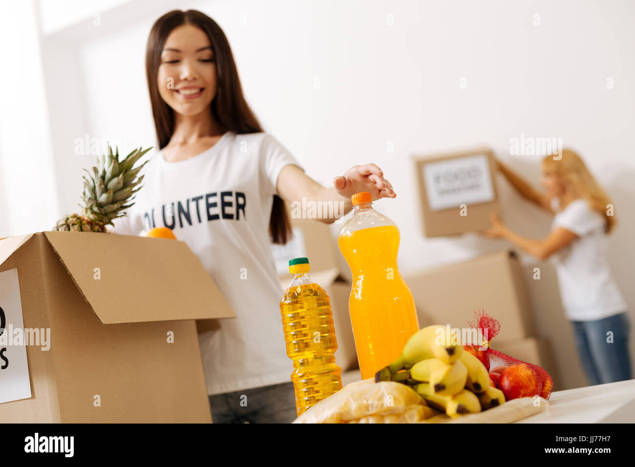 Dedicated altruistic woman canvassing the package - Stock Image
