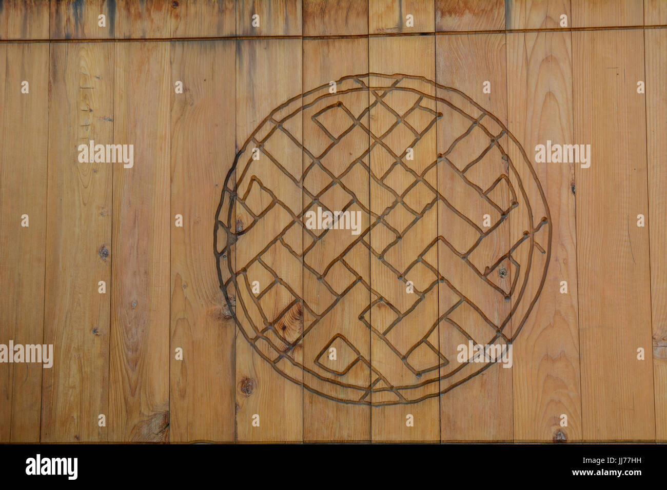 Wooden Door With A Buddhist Symbol At Ancient Temple In Ladakh Stock