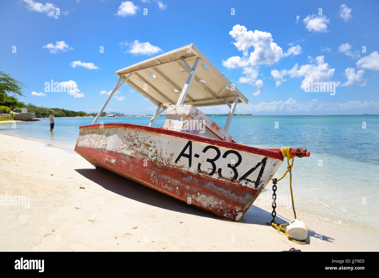shipwrecked fishing boat beached on a beach in aruba, caribbean - Stock Image