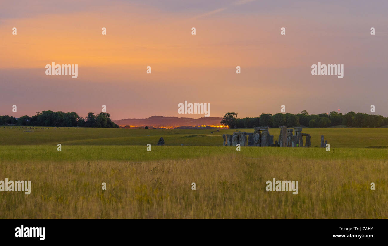 Stonehenge in Wiltshire, England. Take at night you can see a little of the light pollution behind in nearby Larkhill, Stock Photo