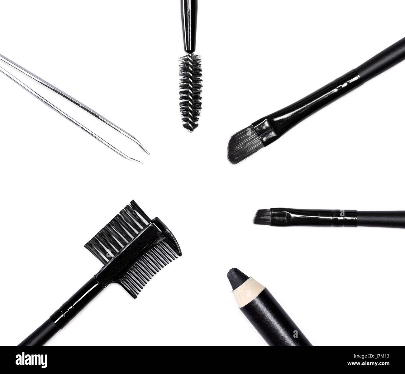 Accessories for care of the brows: eyebrow pencil, angle brushes made from natural bristles, spooly brush, tweezers - Stock Image