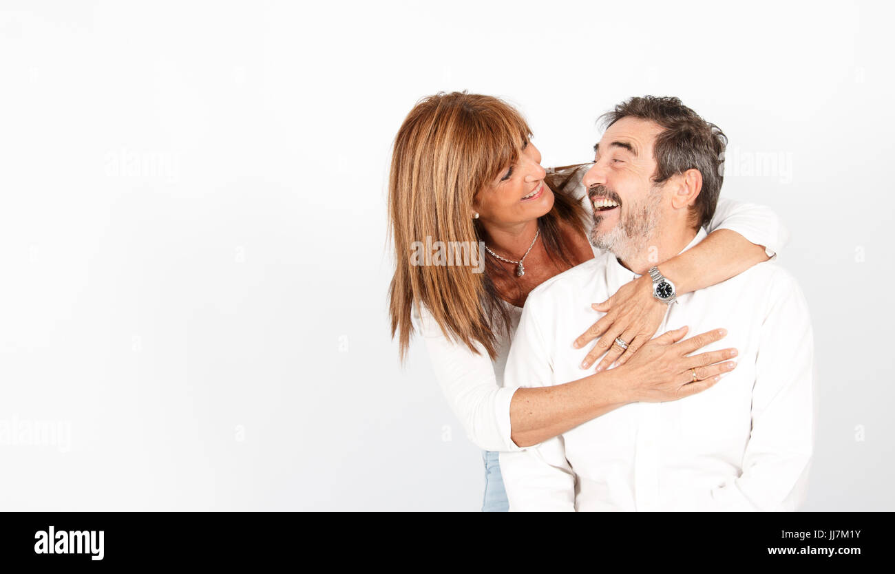 Very funny pictures of a senior couple in a studio playing with a self-timer - Stock Image