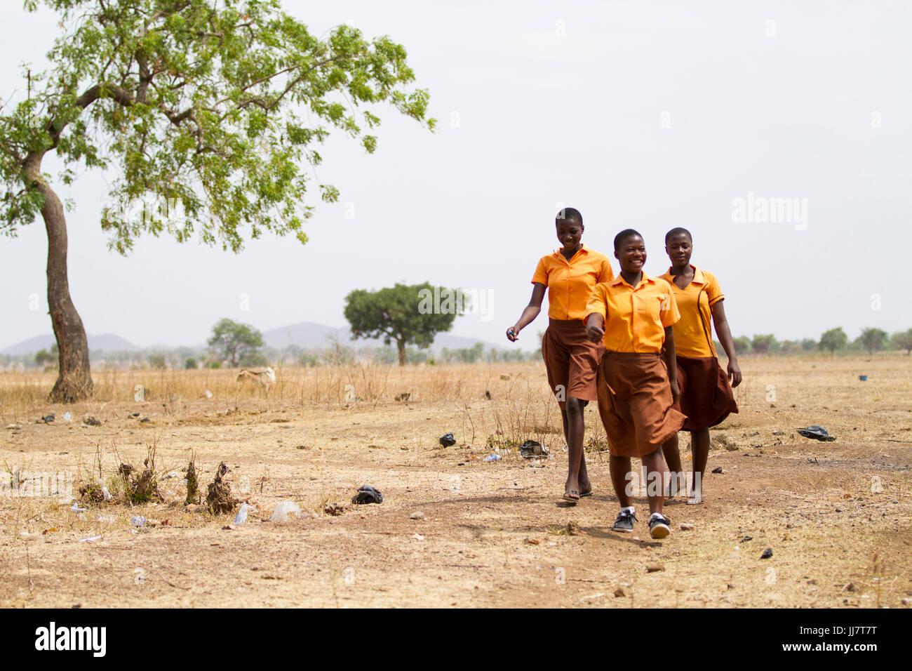 School girls walking to school in the morning, Ghana. - Stock Image
