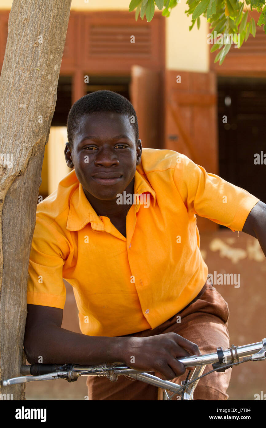 A male student on his bicycle at Junior High School in Talensi Nabdam, Ghana. - Stock Image