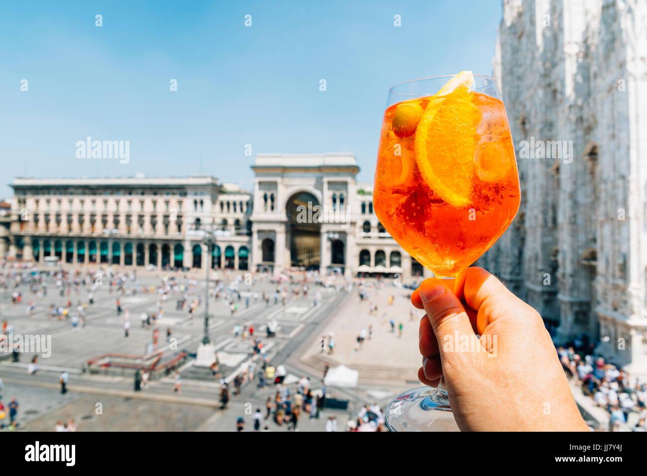Spritz aperol drink in Milan overlooking Piazza Duomo - Stock Image