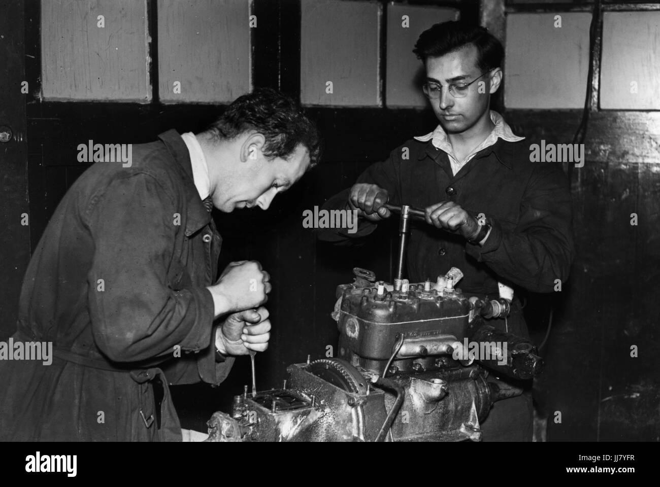 Colin Chapman and Michael Allen in Chapman's workshop. - Stock Image