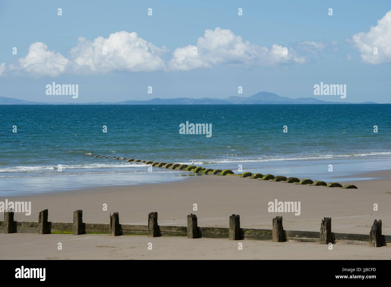 The view from the beach at Barmouth in Wales looking out over Cardigan Bay to the Llŷn Peninsula (Pen Llŷn) on the Stock Photo
