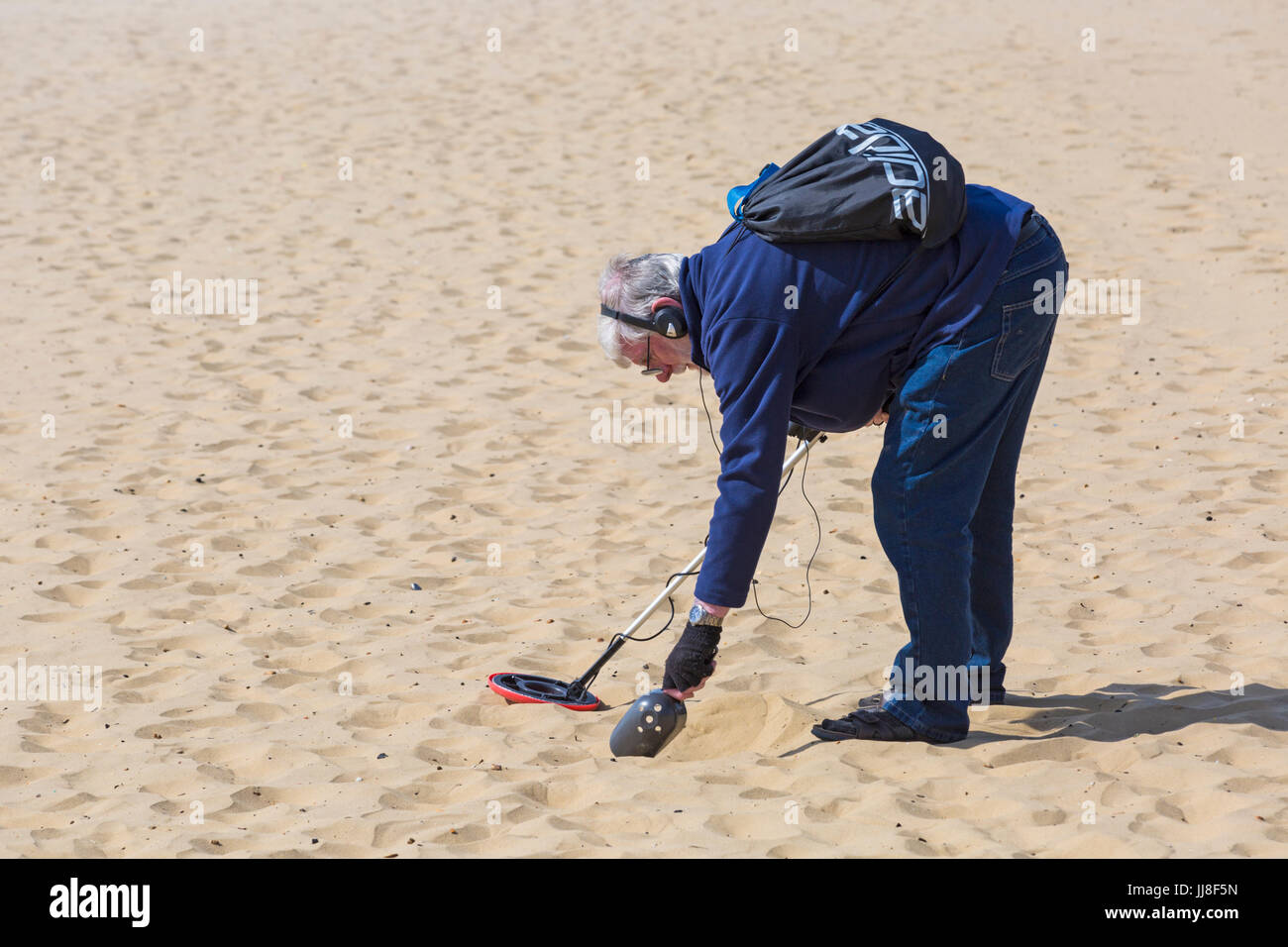 Jew Detector: Man Searching Beach Metal Detector Stock Photos & Man