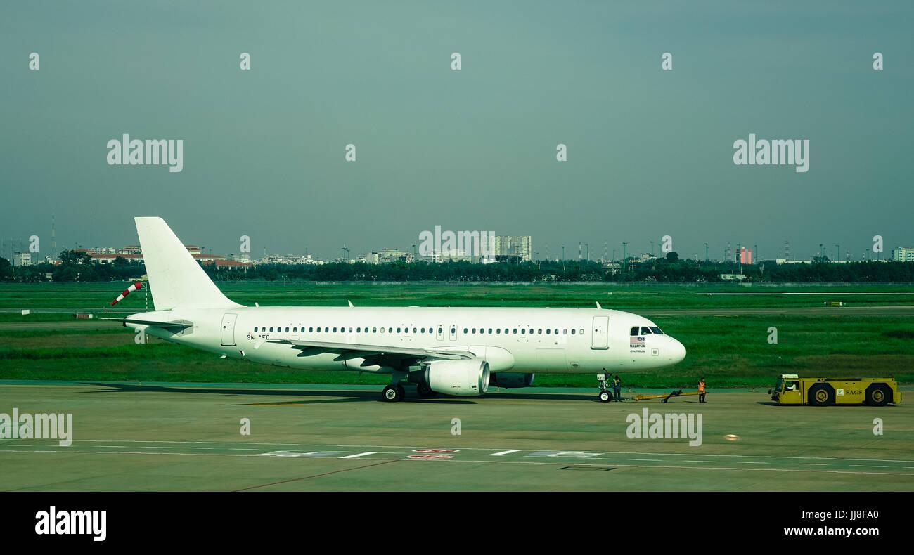 Saigon, Vietnam - Jan 2, 2017. A civil aircraft at Tan Son Nhat Airport in Saigon (Ho Chi Minh City), Vietnam. TSN - Stock Image