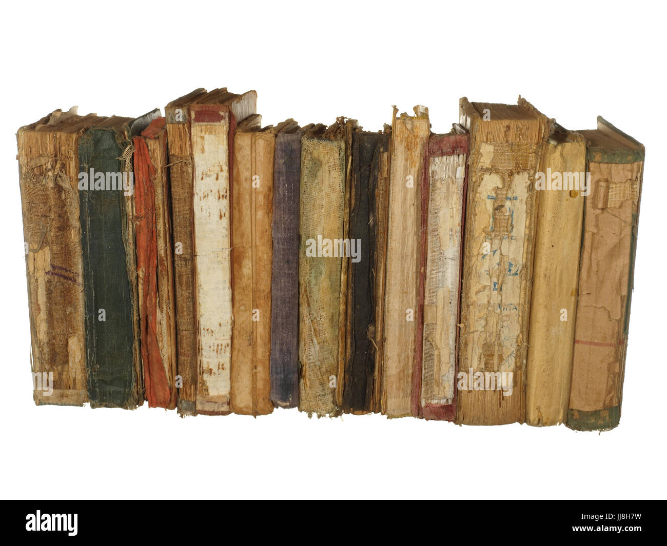 Very old and worn books isolated on white background. Stock Photo