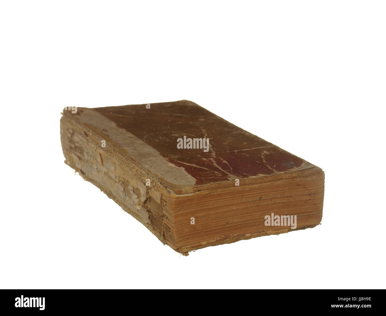 Very old and worn book isolated on white background. Stock Photo