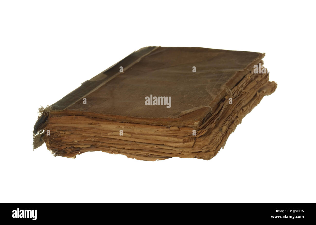 Very old and worn book isolated on white background. - Stock Image
