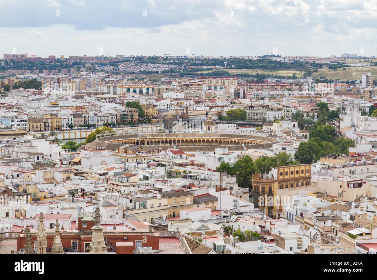 Aerial view of Seville with a focus on Seville's bullring, Plaza de toros de la Real Maestranza de Caballería. - Stock Image
