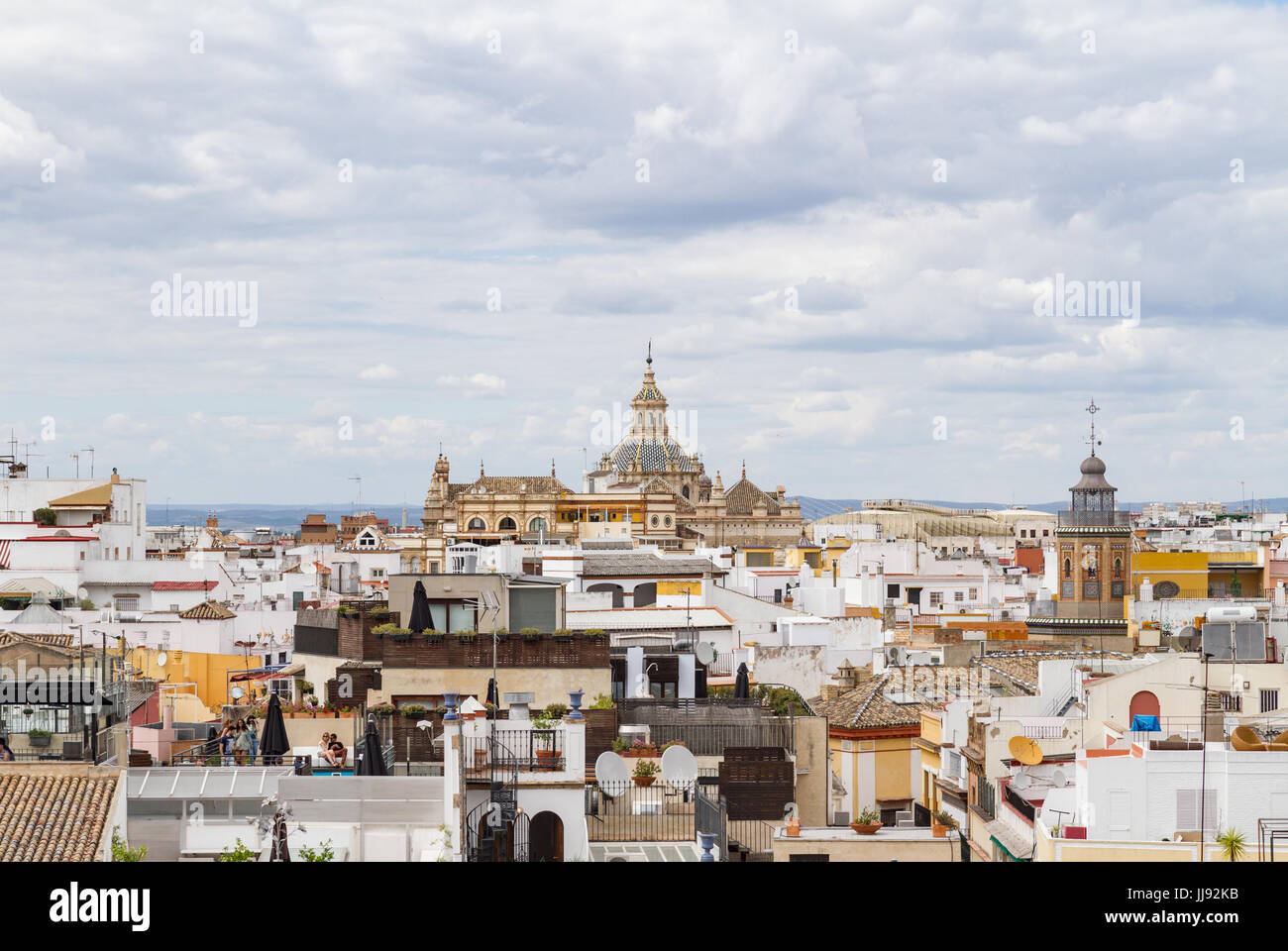 View of Seville with a focus on Seville's Church of San Luis de Los Franceses, an example of Baroque architecture. - Stock Image