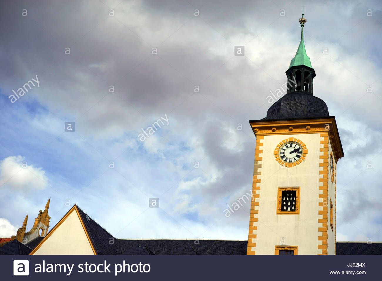 The clock tower on City Hall building in Freiberg, Germany. - Stock Image
