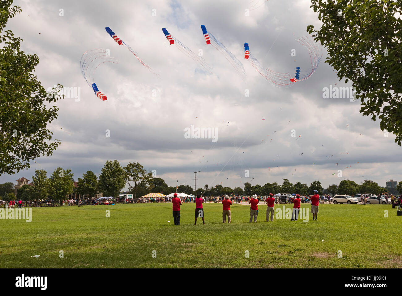Detroit, Michigan - The Windjammers Kite Team performs at the Detroit Kite Festival, held on Belle Isle. Each member - Stock Image