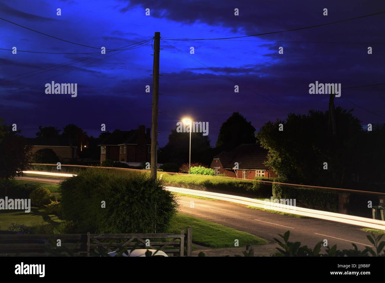Light trail in a small village. - Stock Image