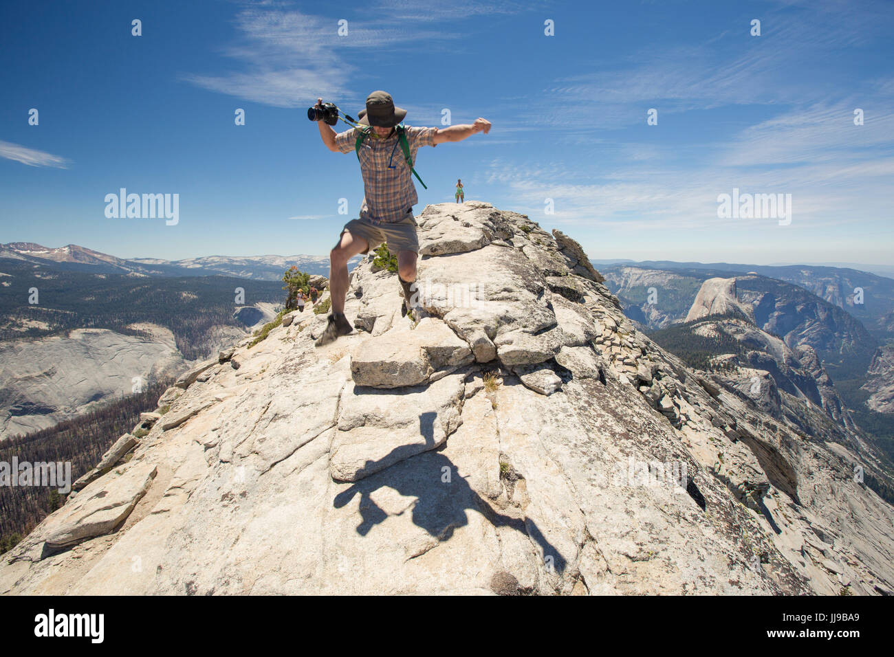 955ac8adac00 A man leaps into the air after hiking Clouds Rest in Yosemite National Park.