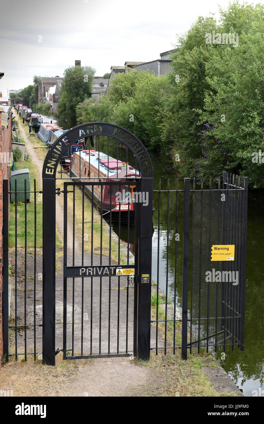 Gated security for the Engine Arm Residential Moorings on a dead-end arm of the Birmingham Canal Navigation in Smethwick, - Stock Image